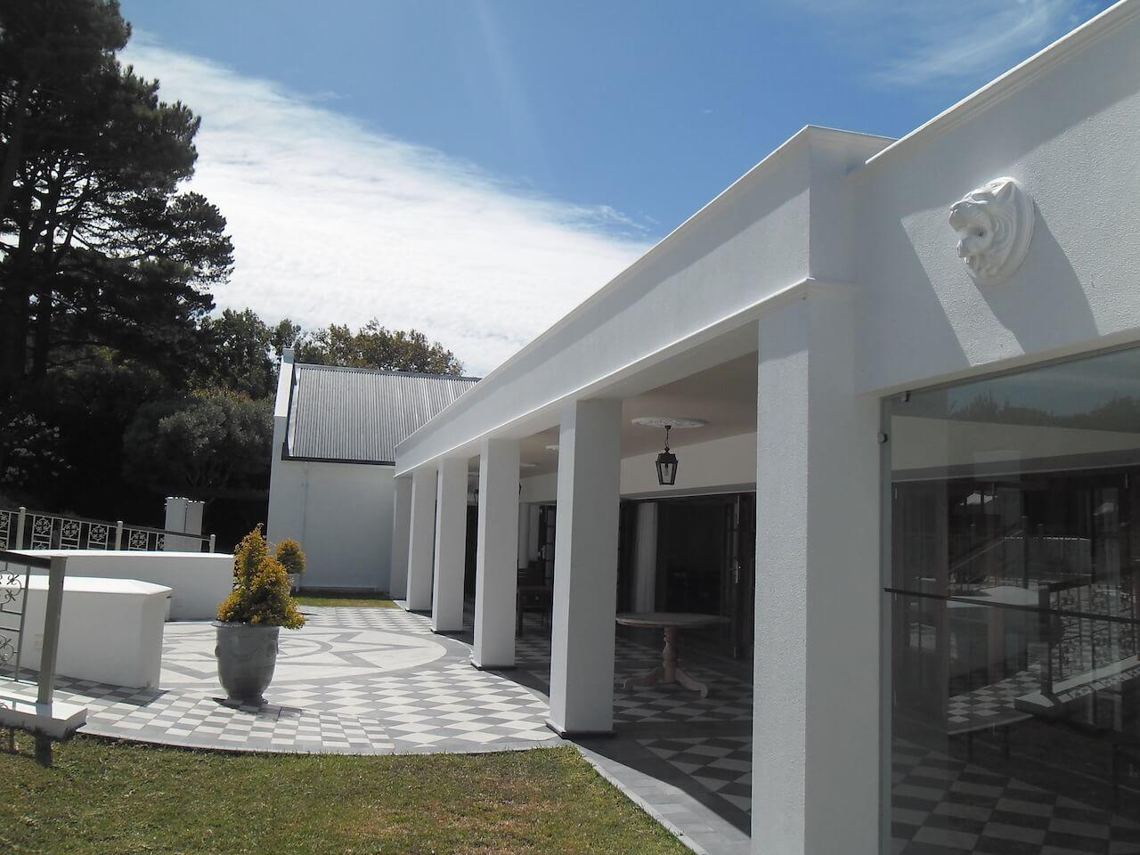 Back Facade With Entry Points to Open Plan Lounge and Communal Dining Areas